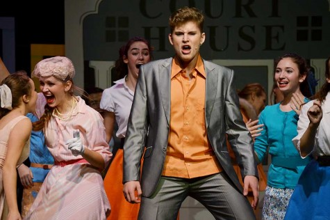 "Senior Erik Baun plays the role of Conrad Birdie in the play ""Bye Bye Birdie."""